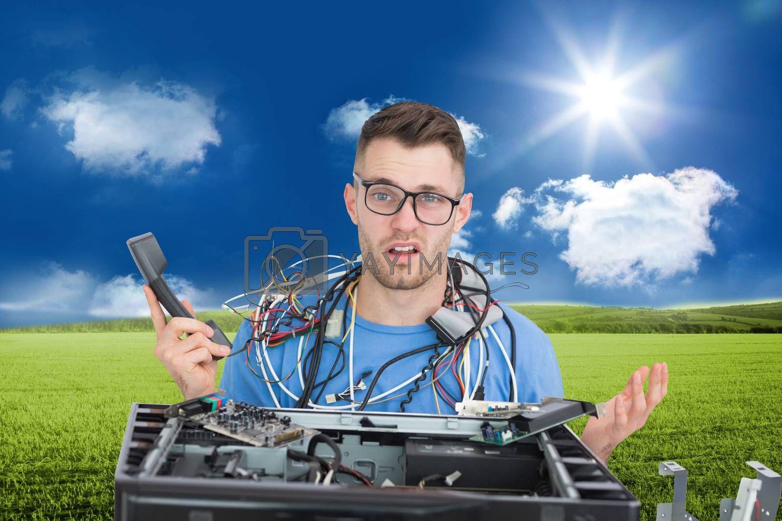 Composite image of confused young it professional with cables and phone in front of open cpu