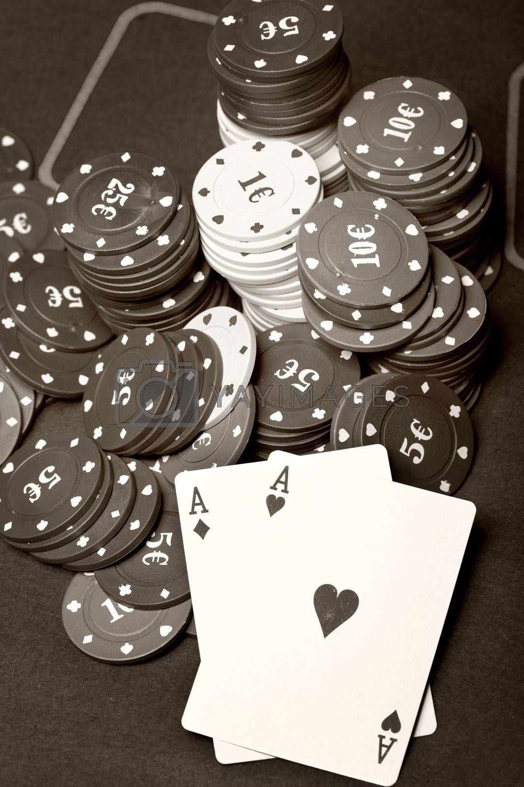 Old poker cards and chips. Sepia toned