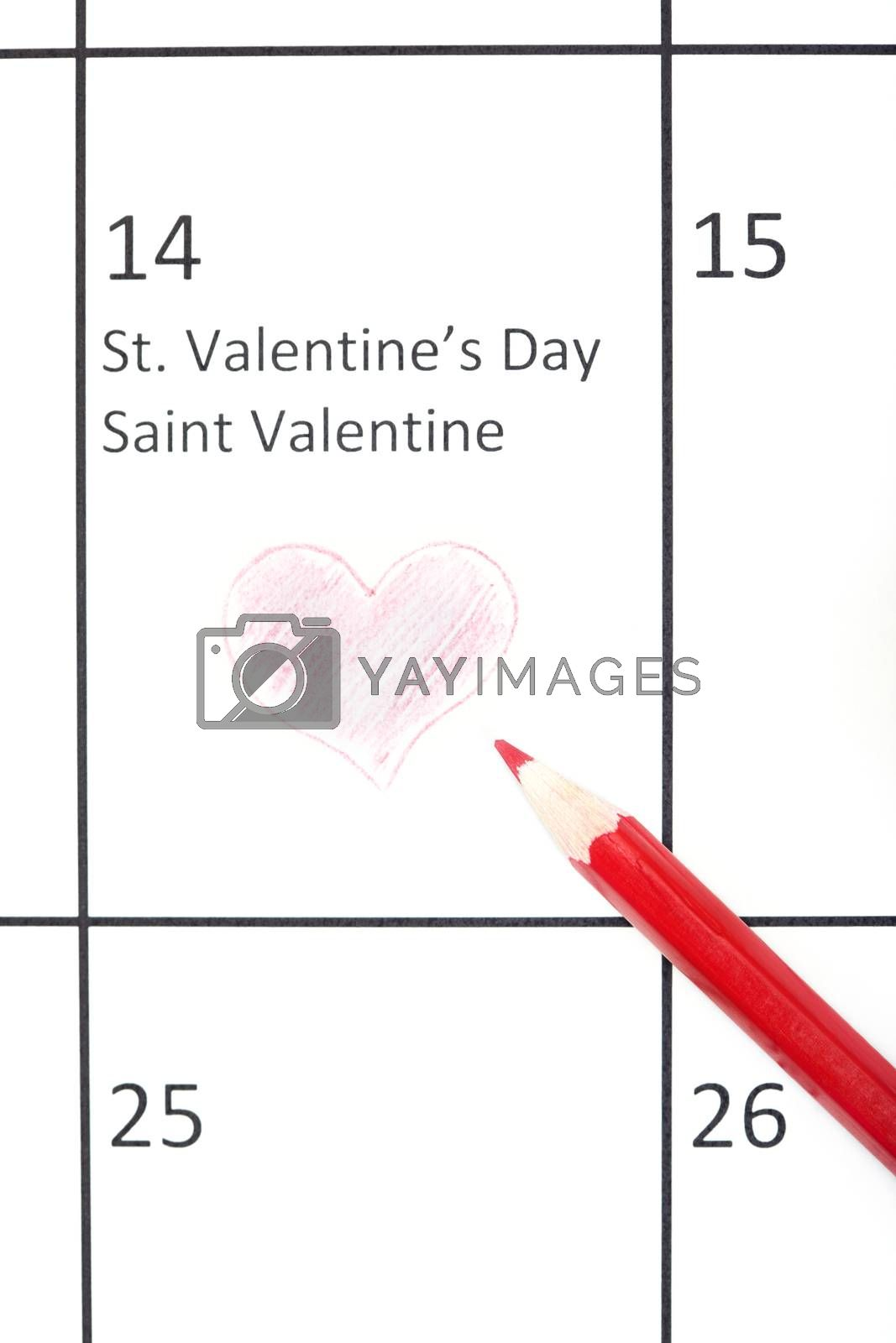 Red pencil on a calendar with Saint Valentine Day