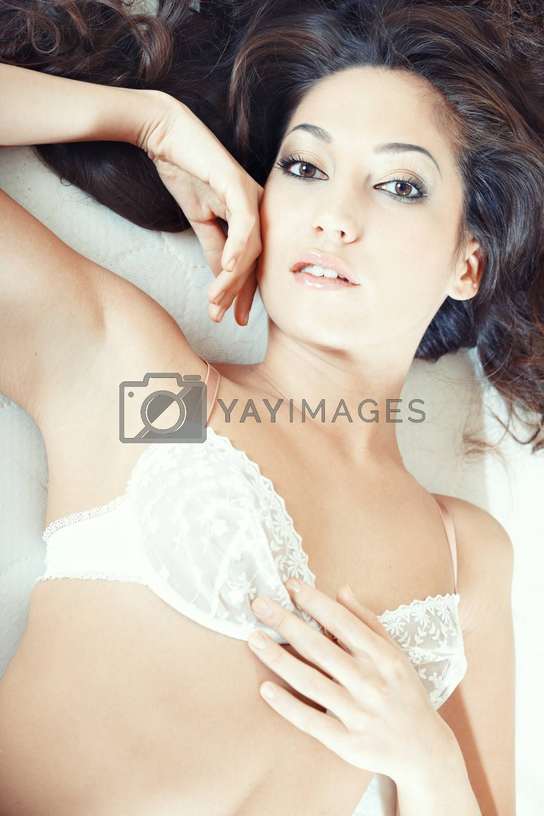 Attractive lady lying on the bed. Close-up portrait
