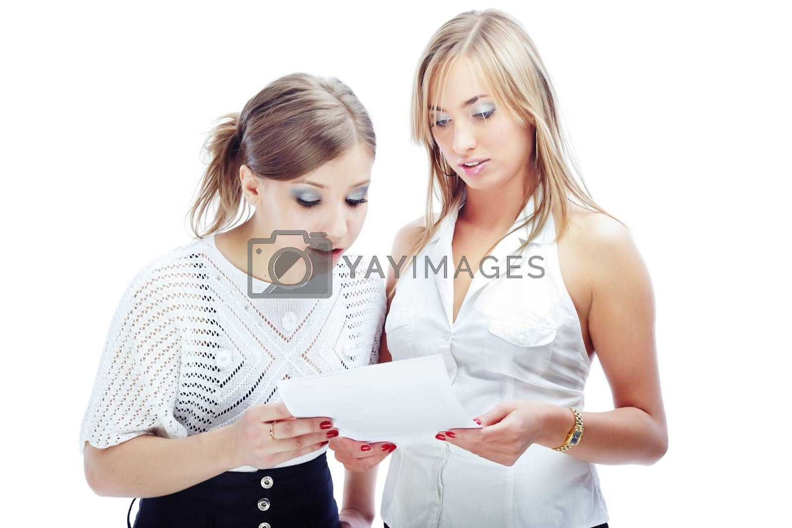 Two women reading the document