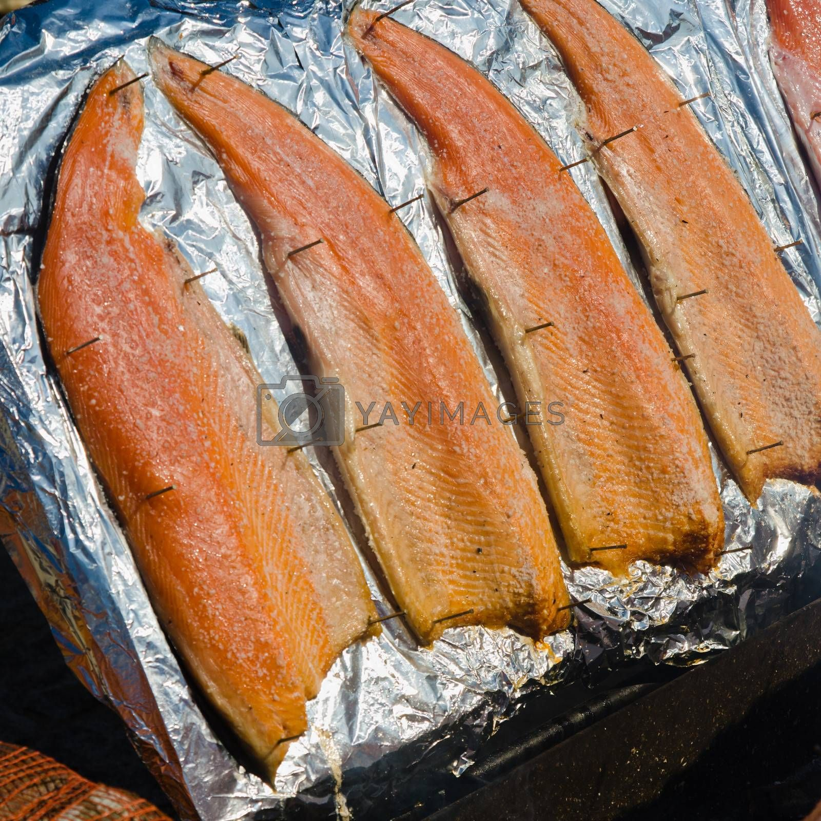 salmon fillet roasted on coals, close-up