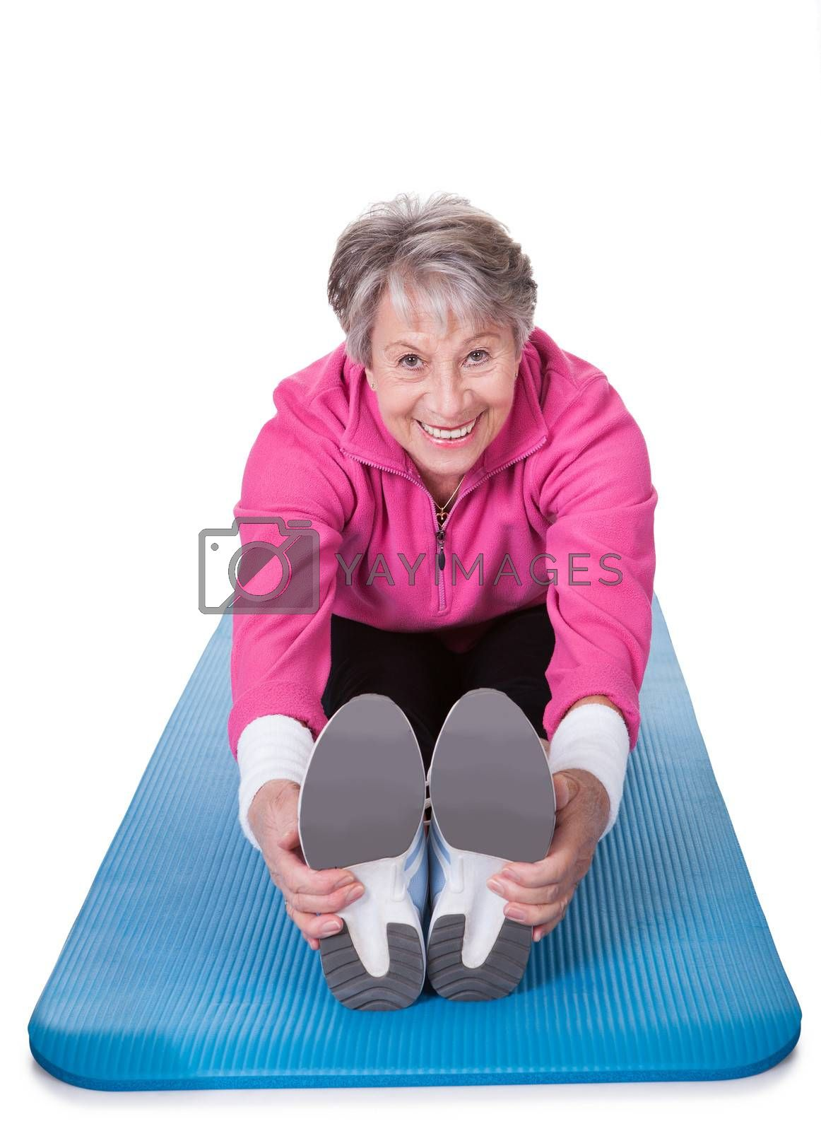 Happy Senior Woman Stretching Her Legs On White Background