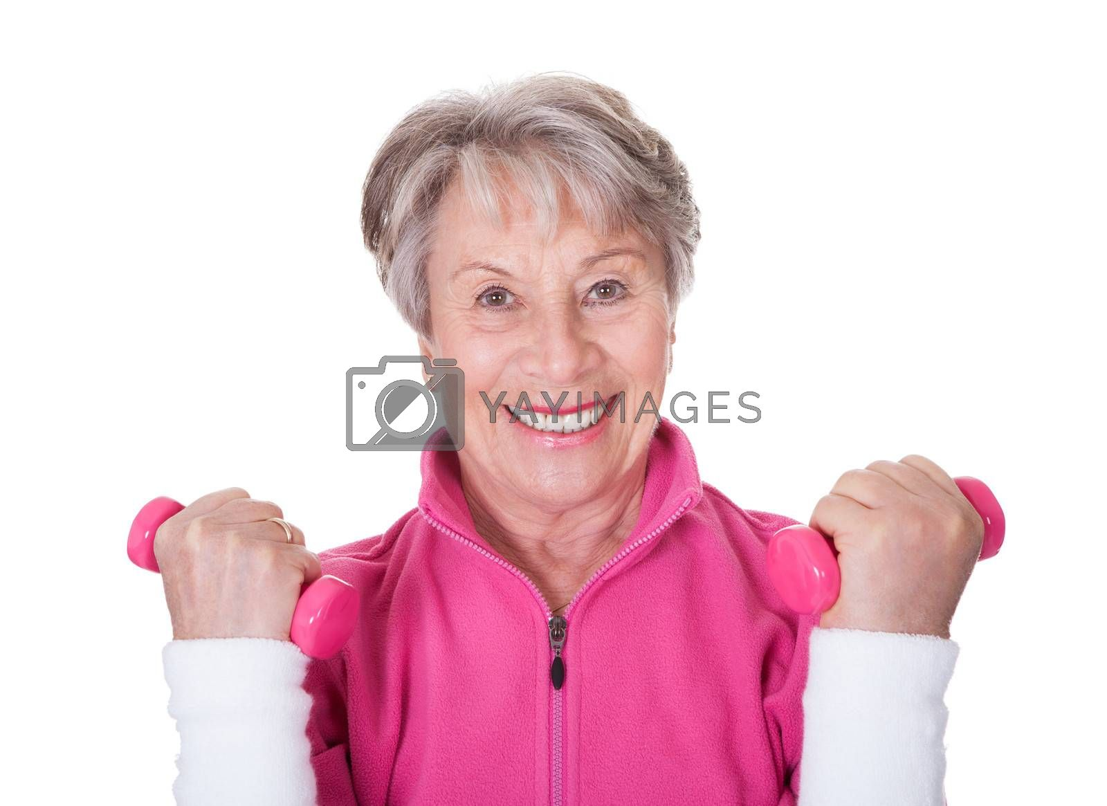 Portrait Of A Senior Woman Exercising On White Background