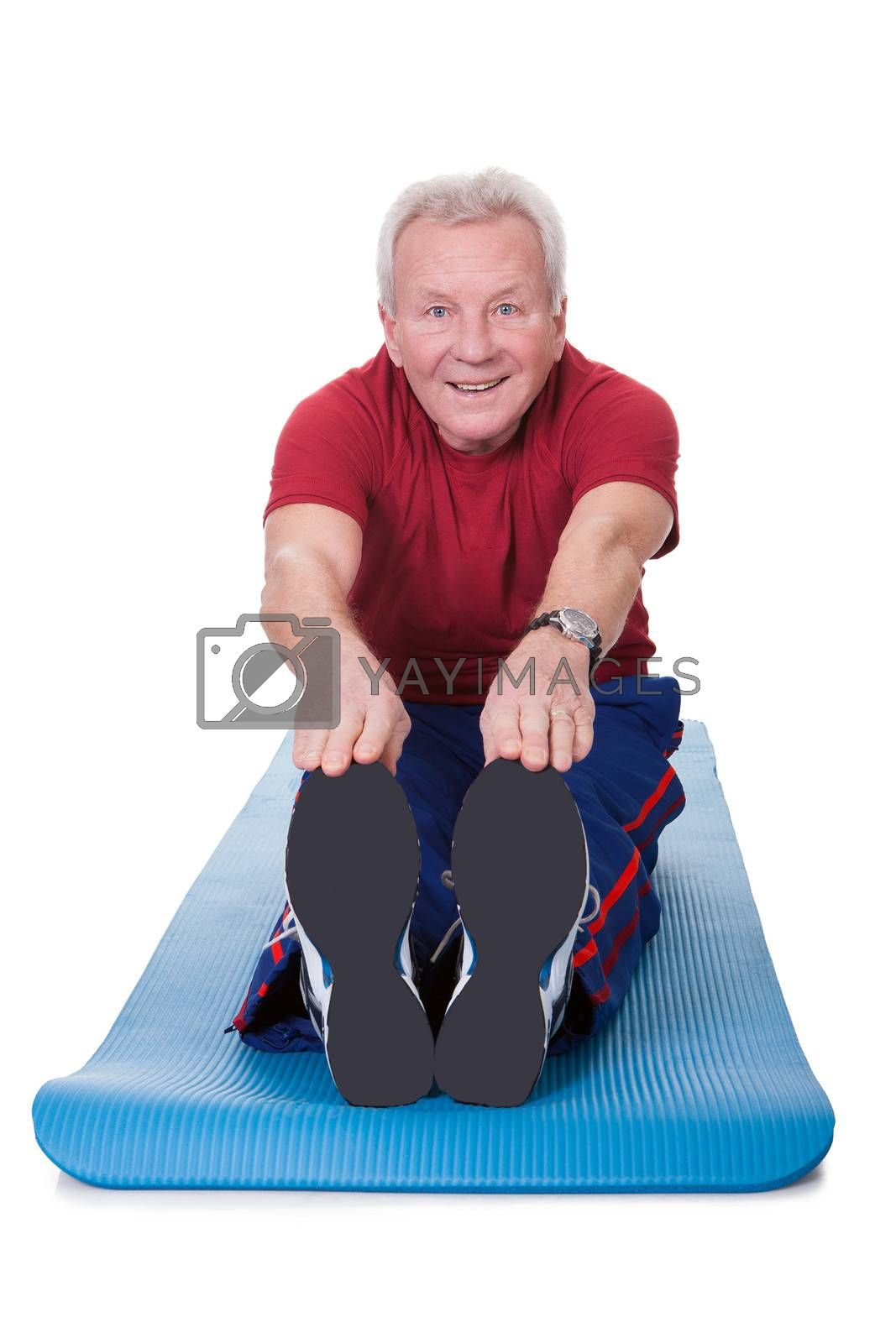 Happy Senior Man Stretching His Legs On White Background