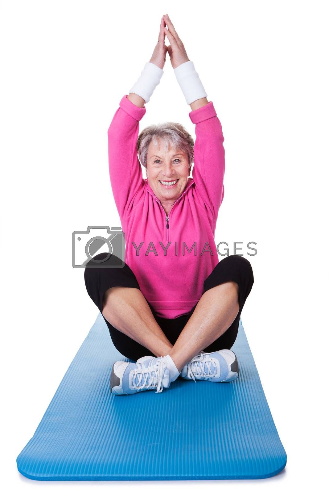 Senior Woman Practicing Yoga On White Background