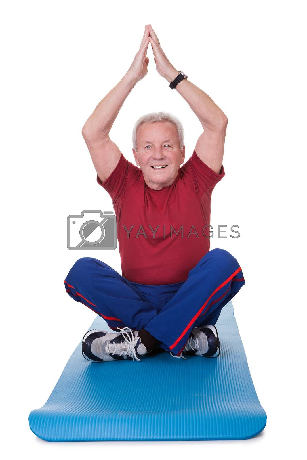 Senior Man Practicing Yoga On White Background