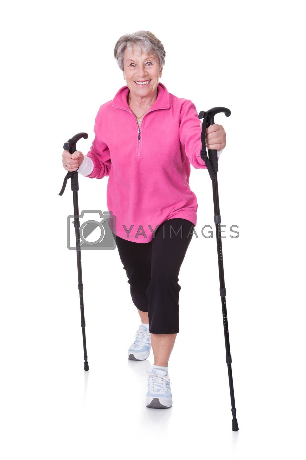 Senior Woman Walking With Hiking Poles On White Backgrounds