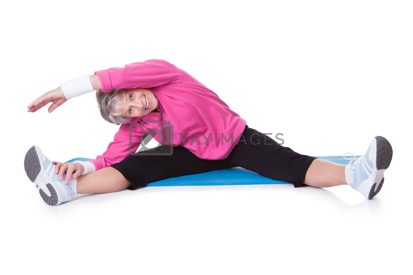 Portrait Of Senior Woman Exercising On White Background