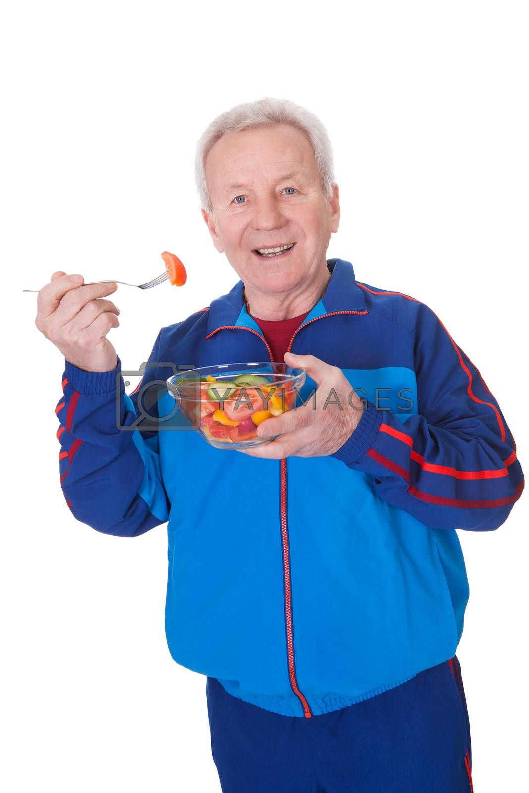 Portrait Of Happy Senior Man Eating Salad On White Background