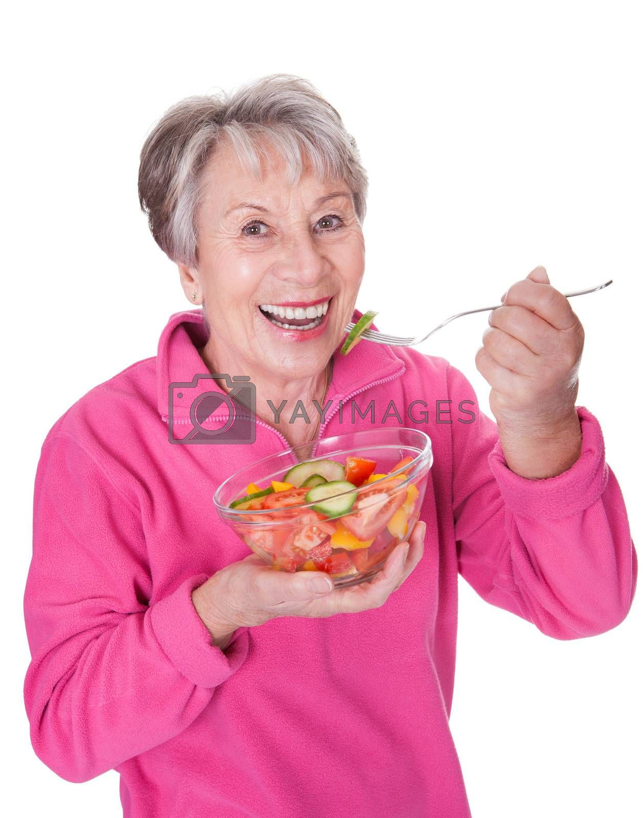 Portrait Of Happy Senior Woman Eating Salad On White Background