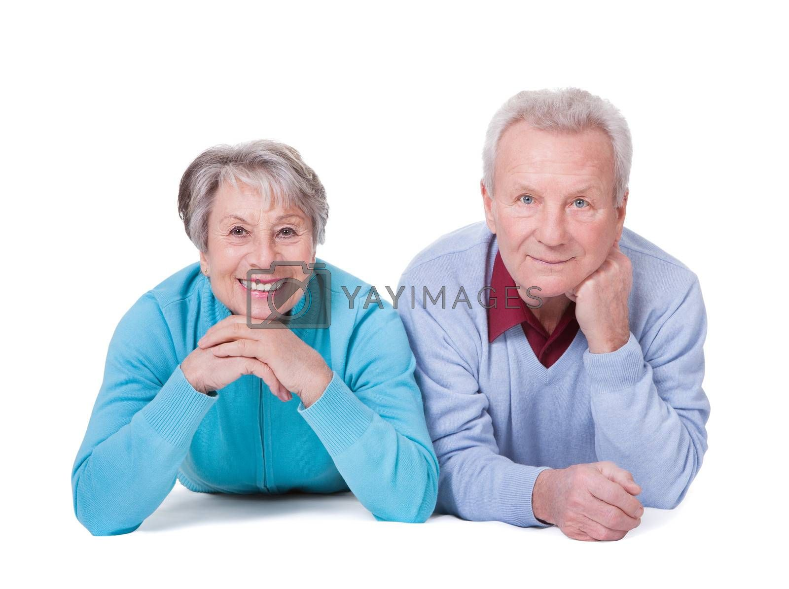Portrait Of Happy Senior Couple Lying Over White Background