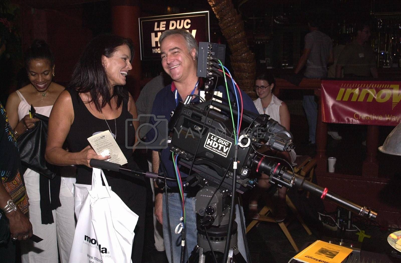 Denise Brown checks out the new High Definition movie cameras at the Moviemaking Technology Showcase, featuring cutting edge movie technology, as well as two fashion shows, The Century Club, Century City, CA, 09-03-02
