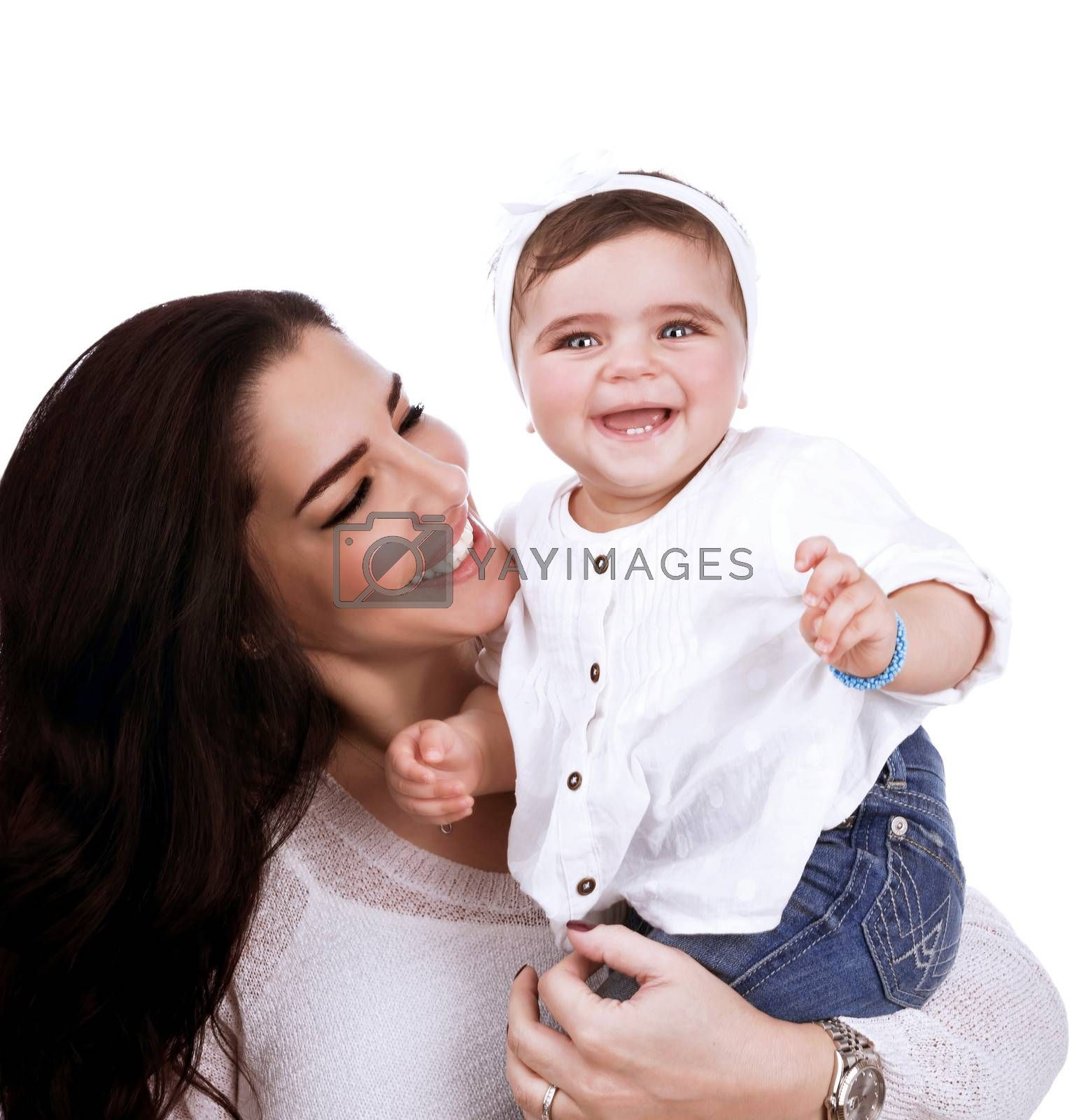 Closeup portrait of attractive female looking on adorable cute daughter, having fun in the studio, happy arabic family, love concept