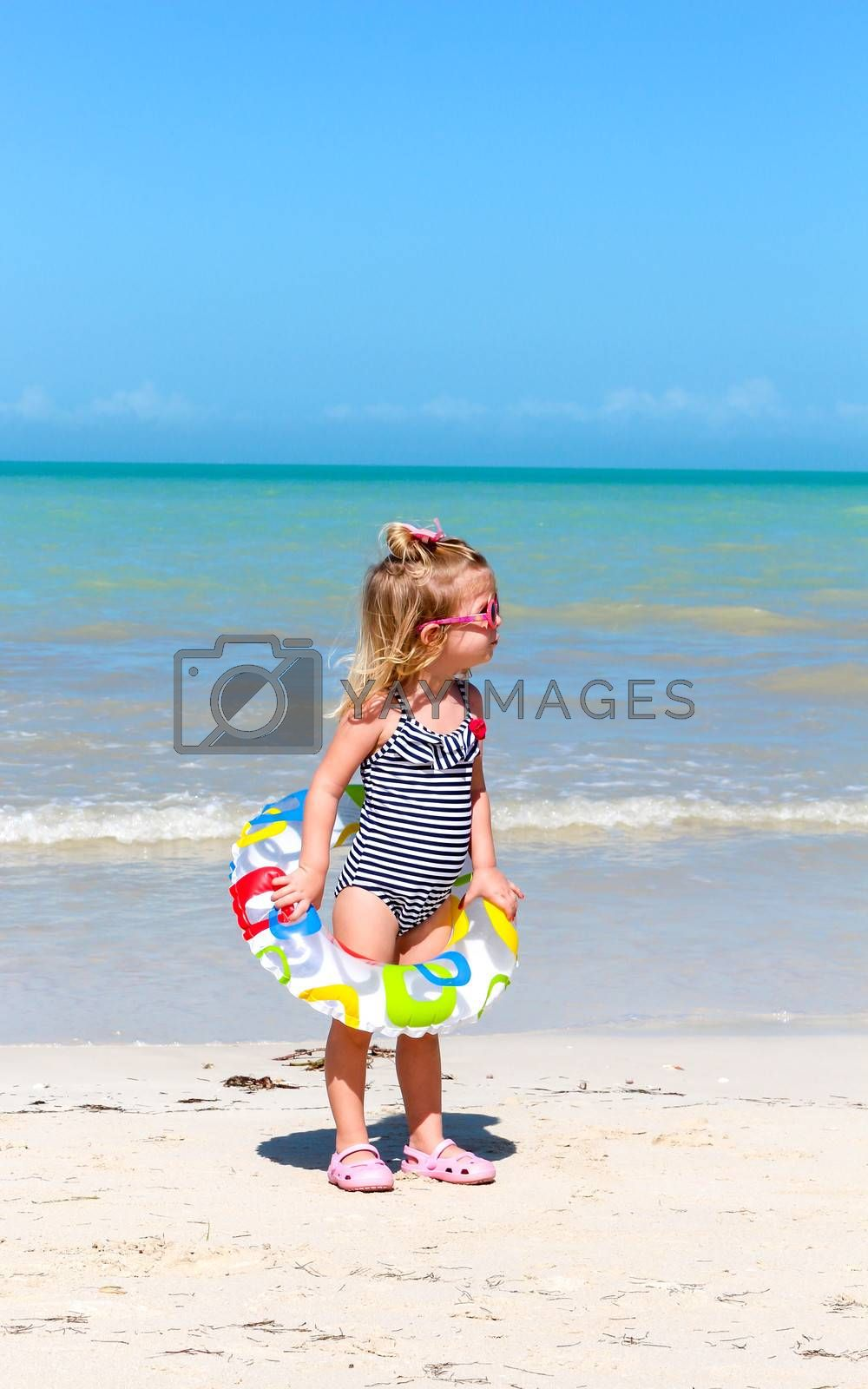 Cute girl having fun on vacations at the beach