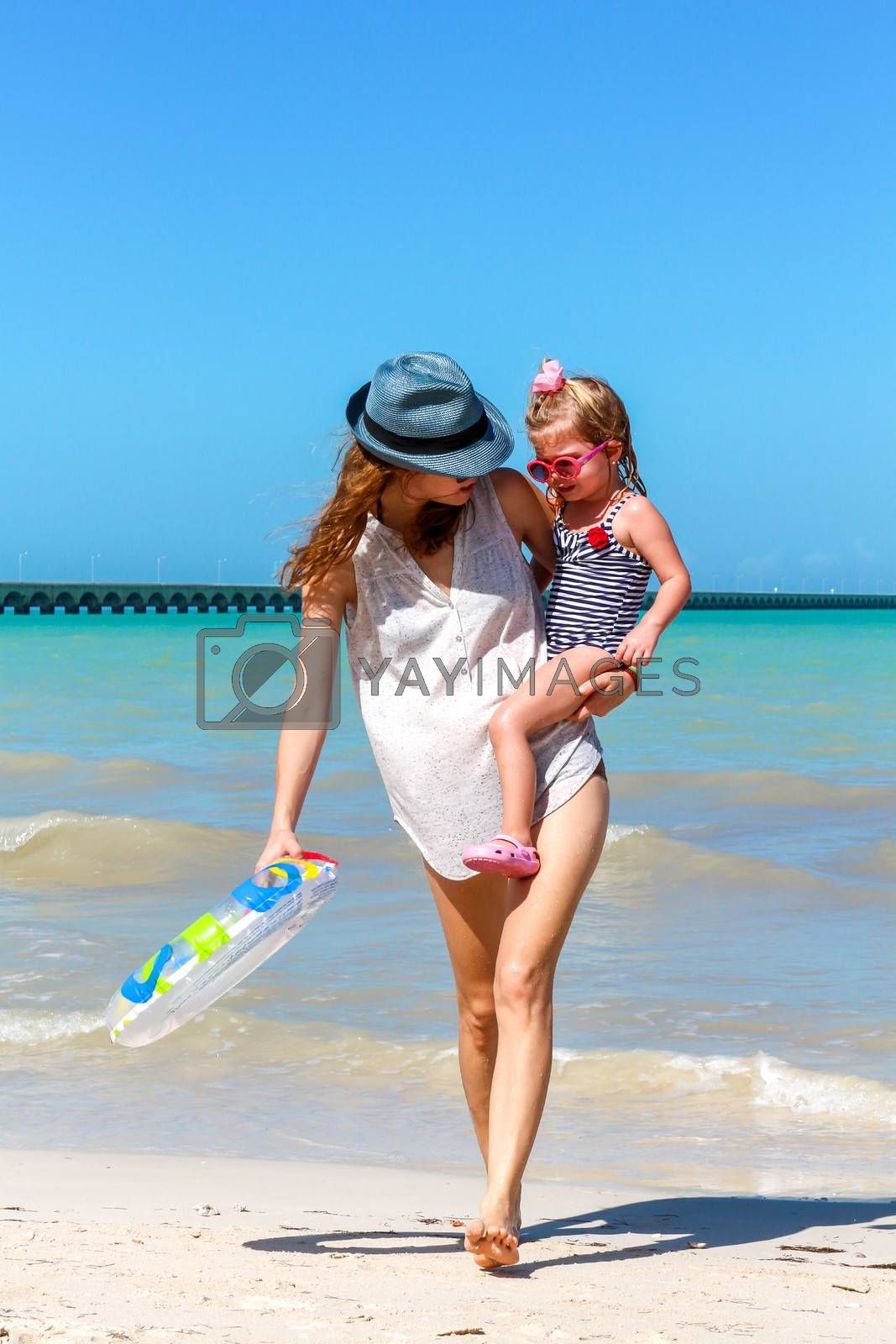 Mom and child playing on a Yucatan peninsula beach