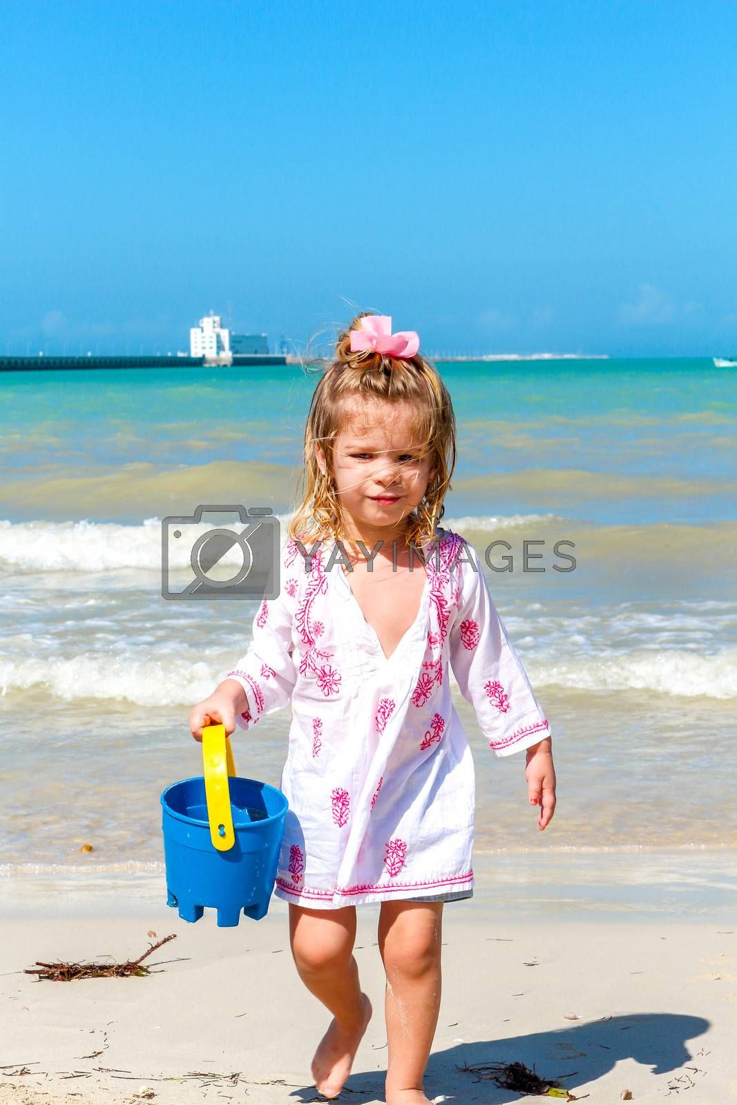 Little girl playing at a yucatan beach