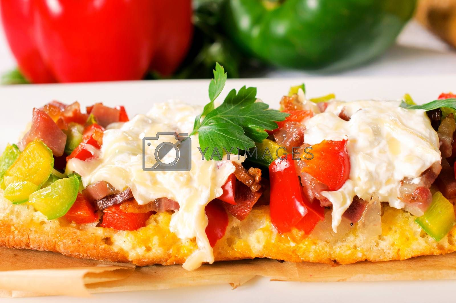 Baguette bread stuffed with meat and peppers.Selective focus in the middle