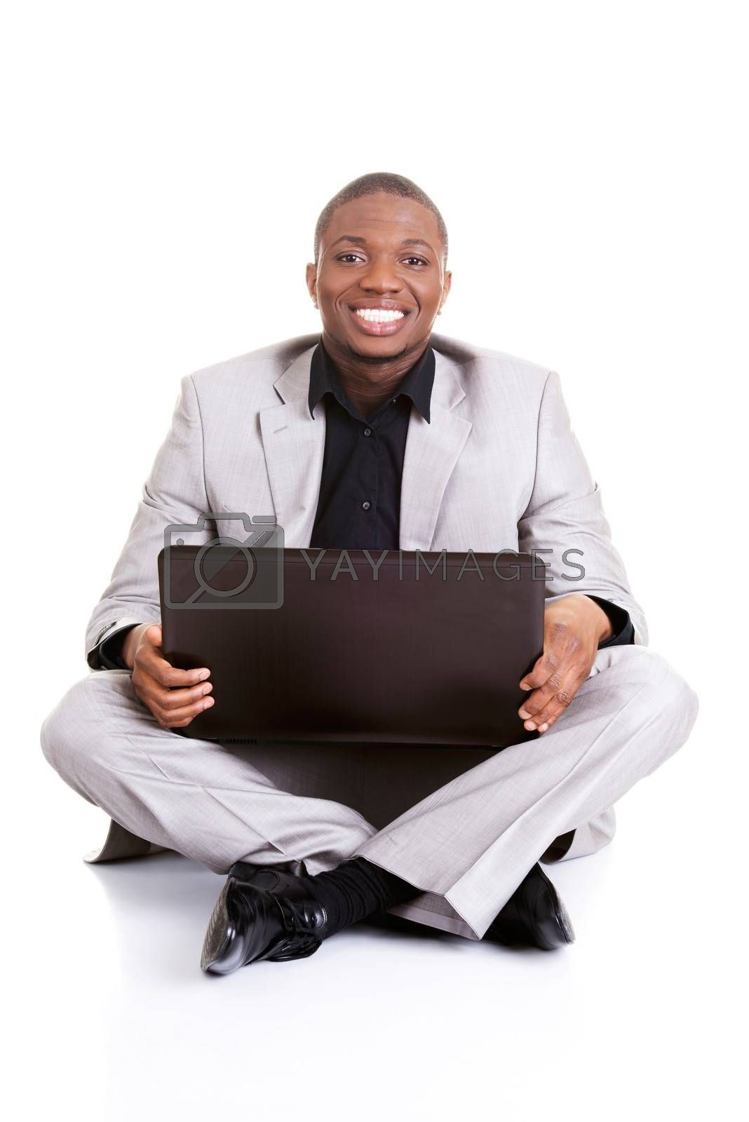 Successful businessman working on laptop, isolated on white