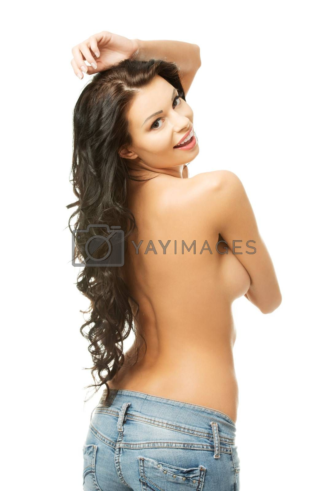 Beautiful fit erotic woman in blue jeans, isolated on white background