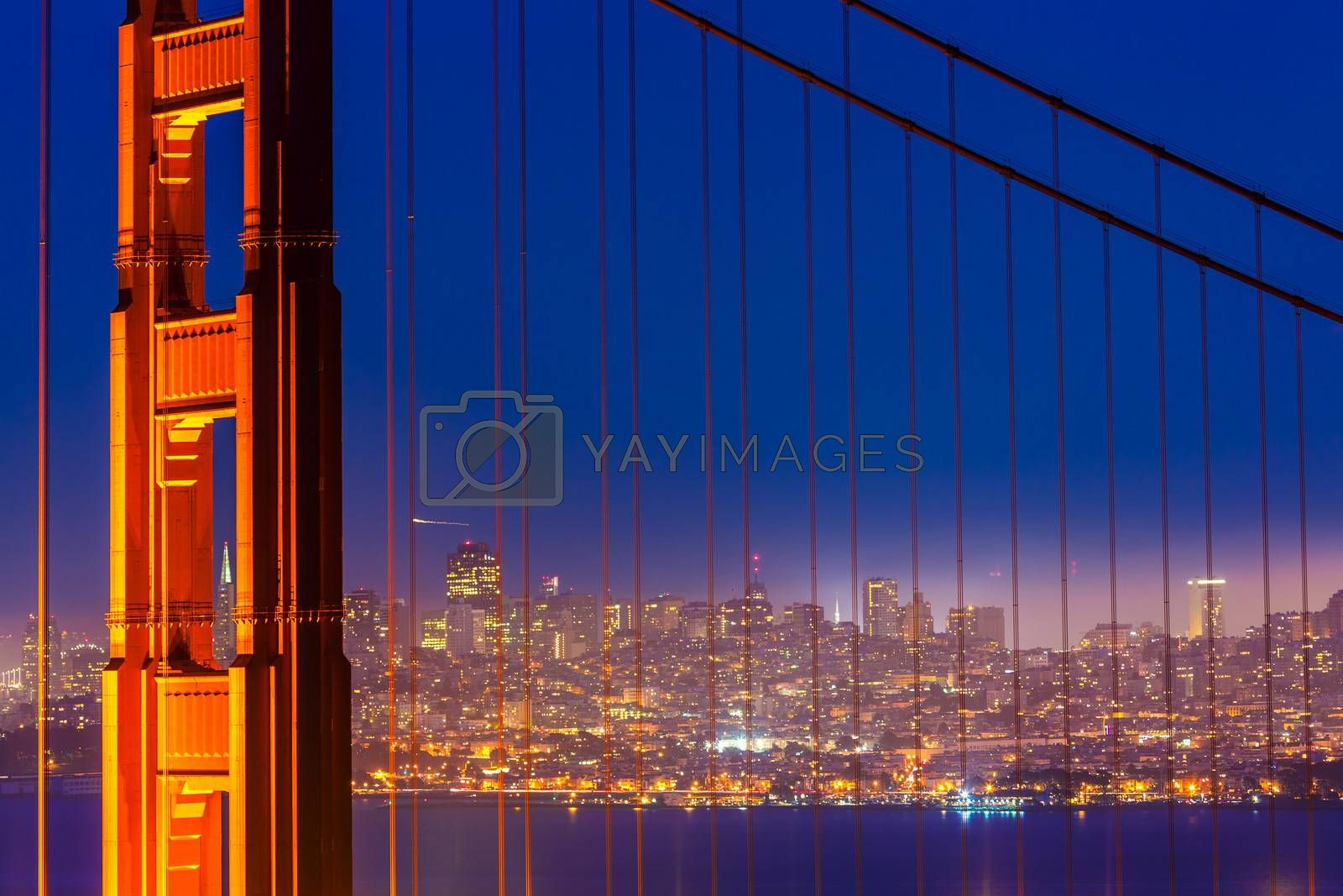 Royalty free image of San Francisco Golden Gate Bridge sunset through cables by lunamarina