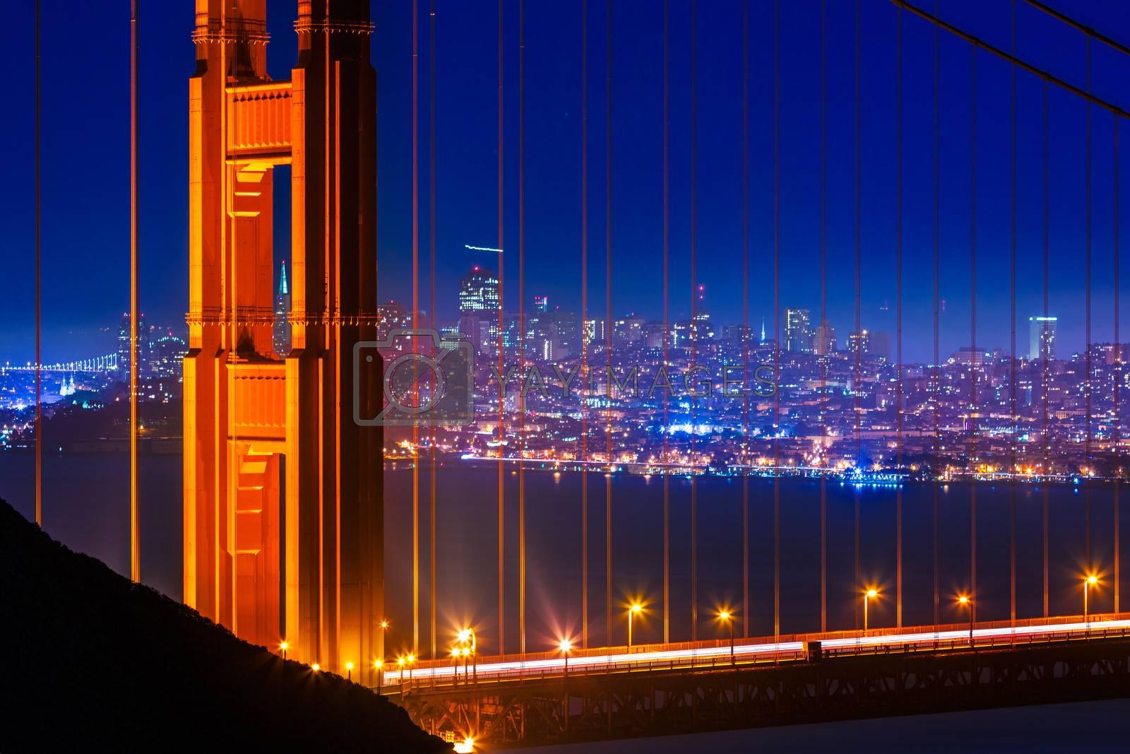 Royalty free image of Golden Gate Bridge San Francisco sunset through cables by lunamarina