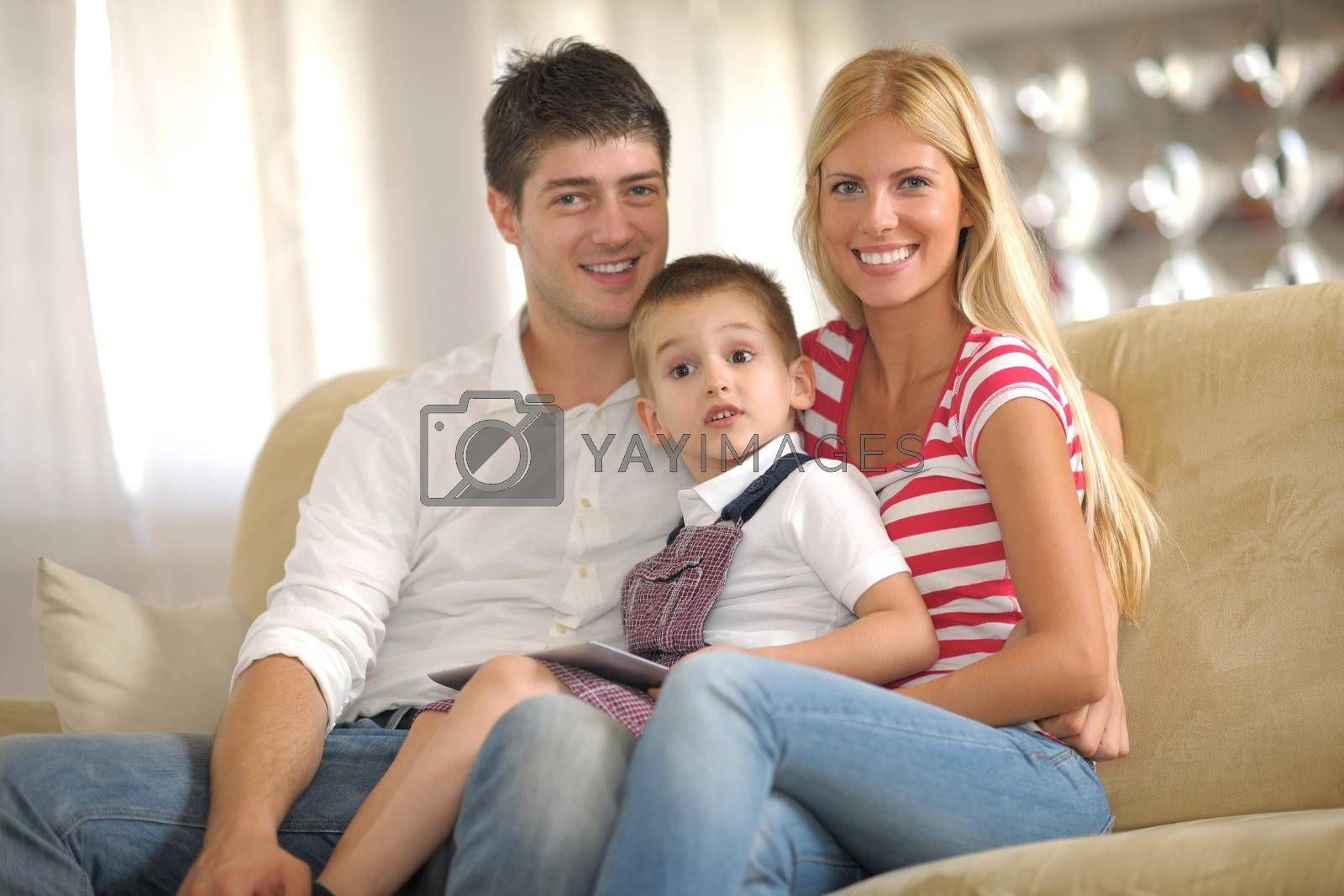 Royalty free image of family at home by .shock