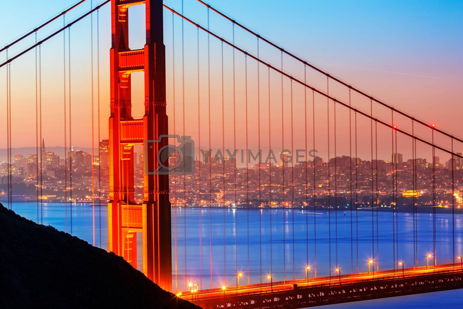 Royalty free image of San Francisco Golden Gate Bridge sunrise through cables by lunamarina
