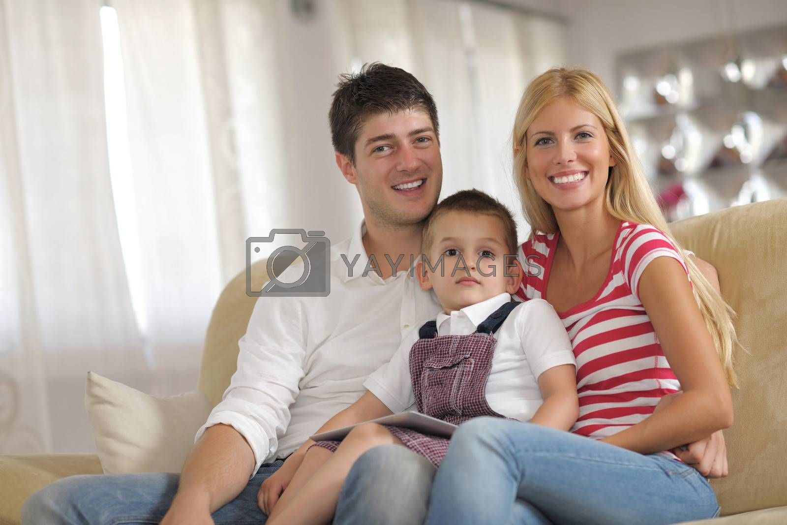 Royalty free image of family at home using tablet computer by .shock