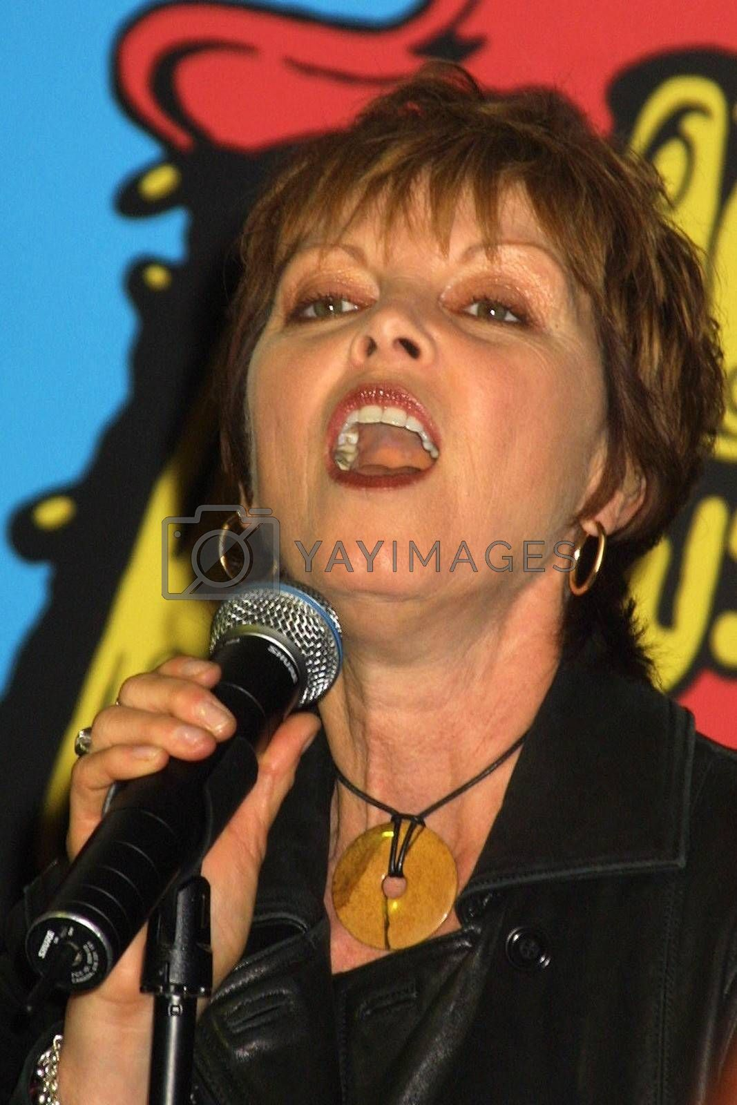 Royalty free image of Pat Benatar and Neil Giraldo In-Store by ImageCollect