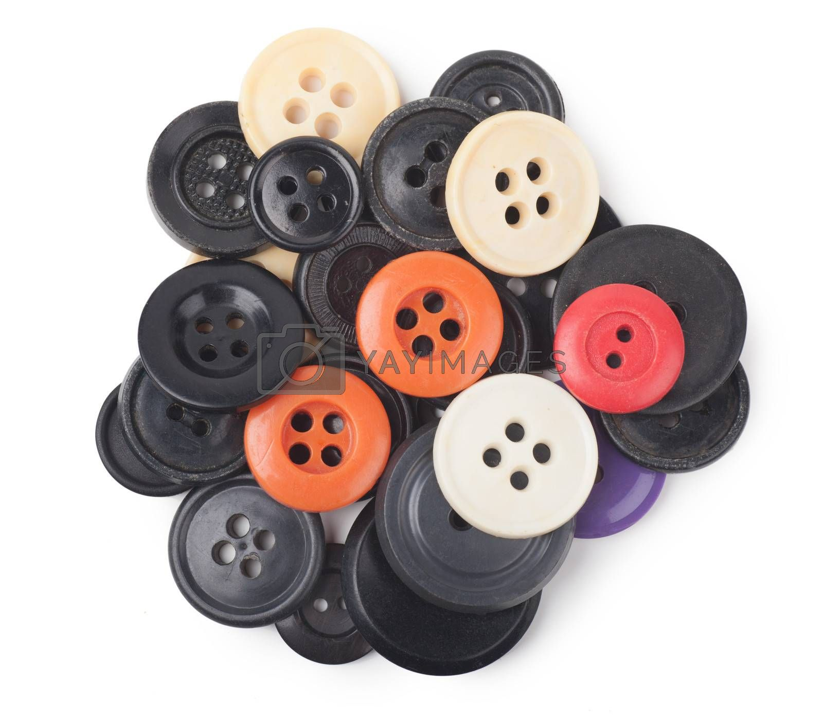 Heap of old-fashioned retro buttons over white background