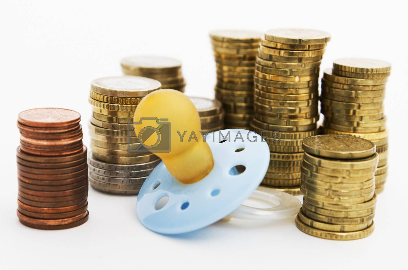 pacifier with hard money in background as symbol for the cost of parenthood