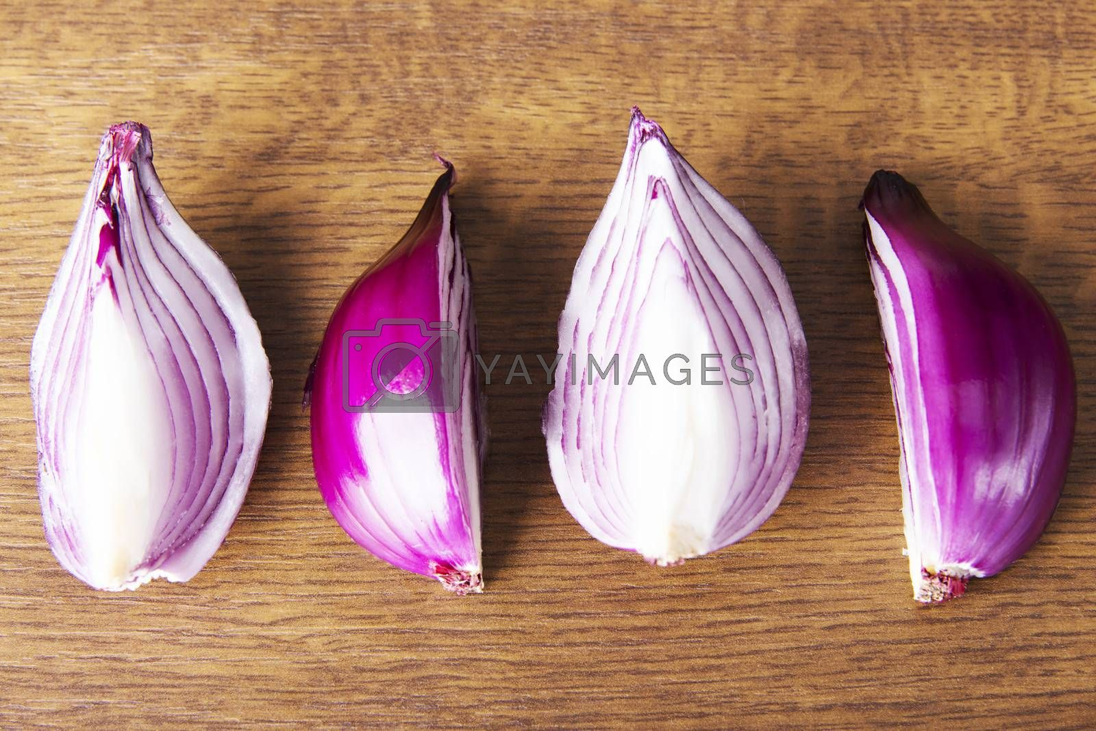 Composition of red onions. Over wooden background.