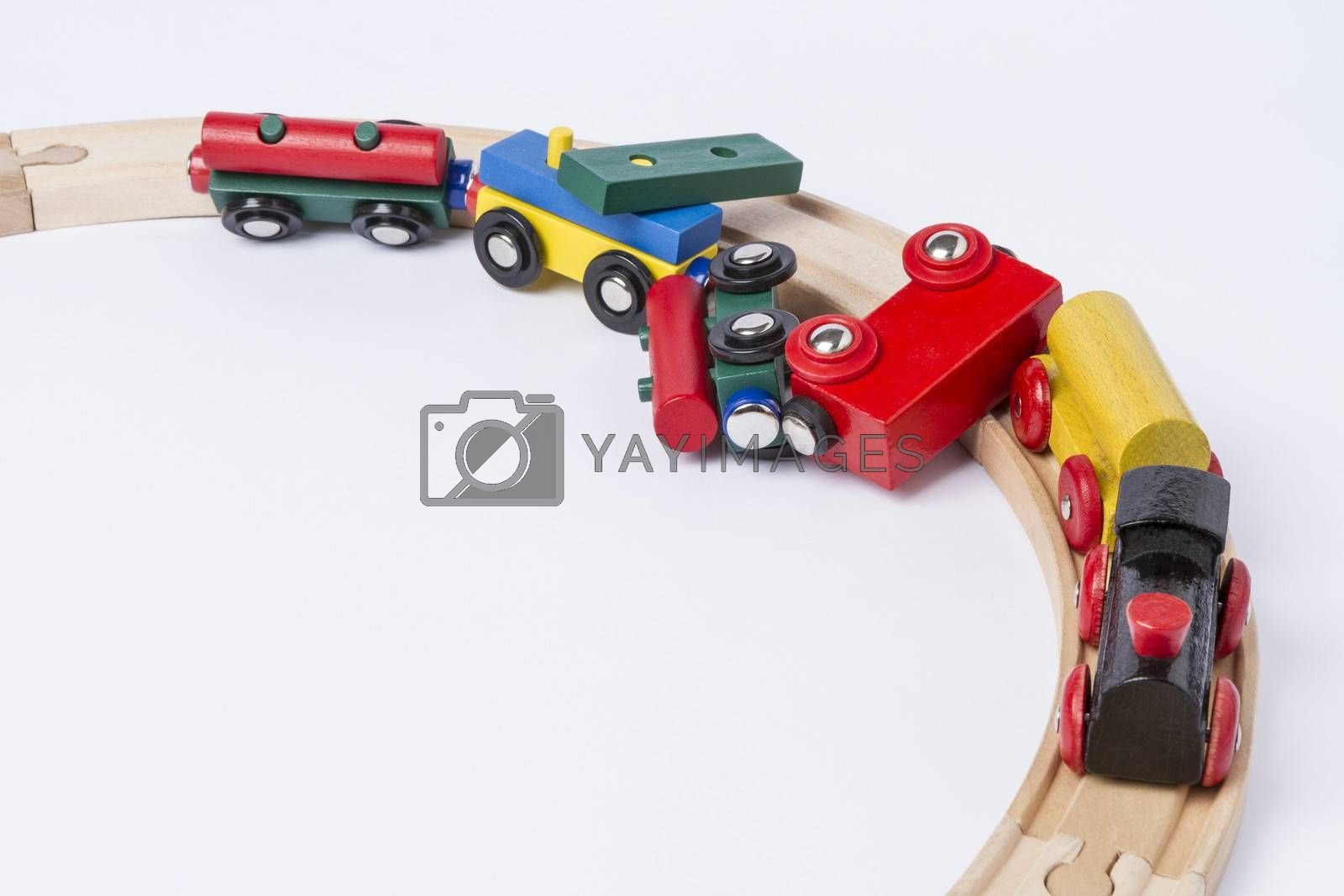 derail wooden toy train in top view. horizontal image