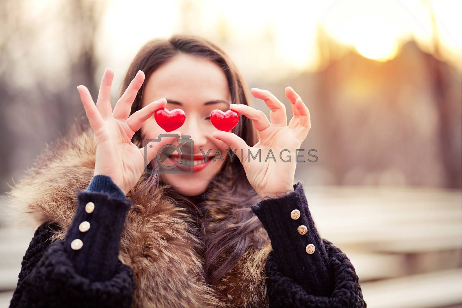 Pretty woman holding red hearts on Valentines day