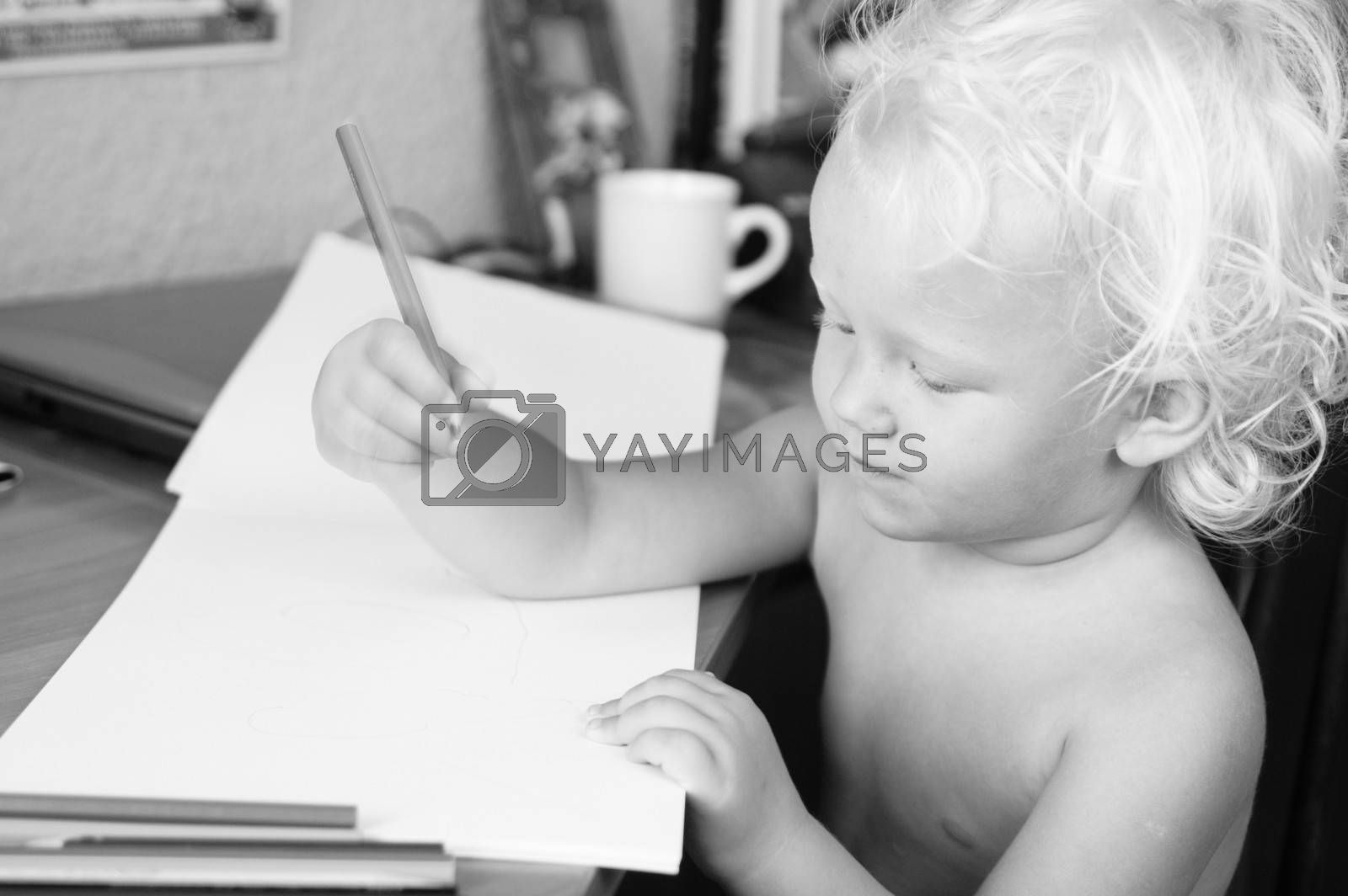 Black and white portrait of a small drawing of the child