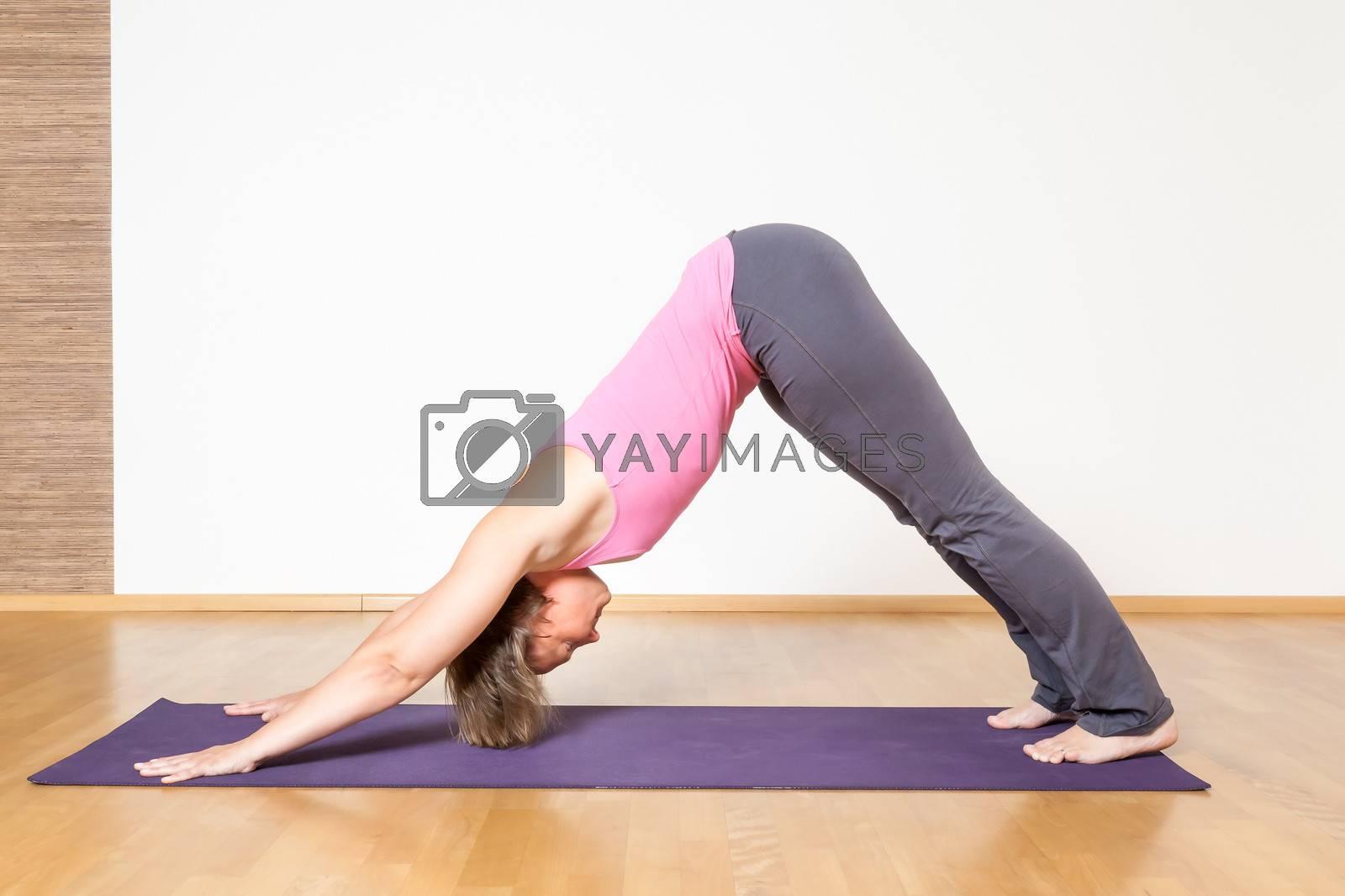 An image of a woman doing yoga