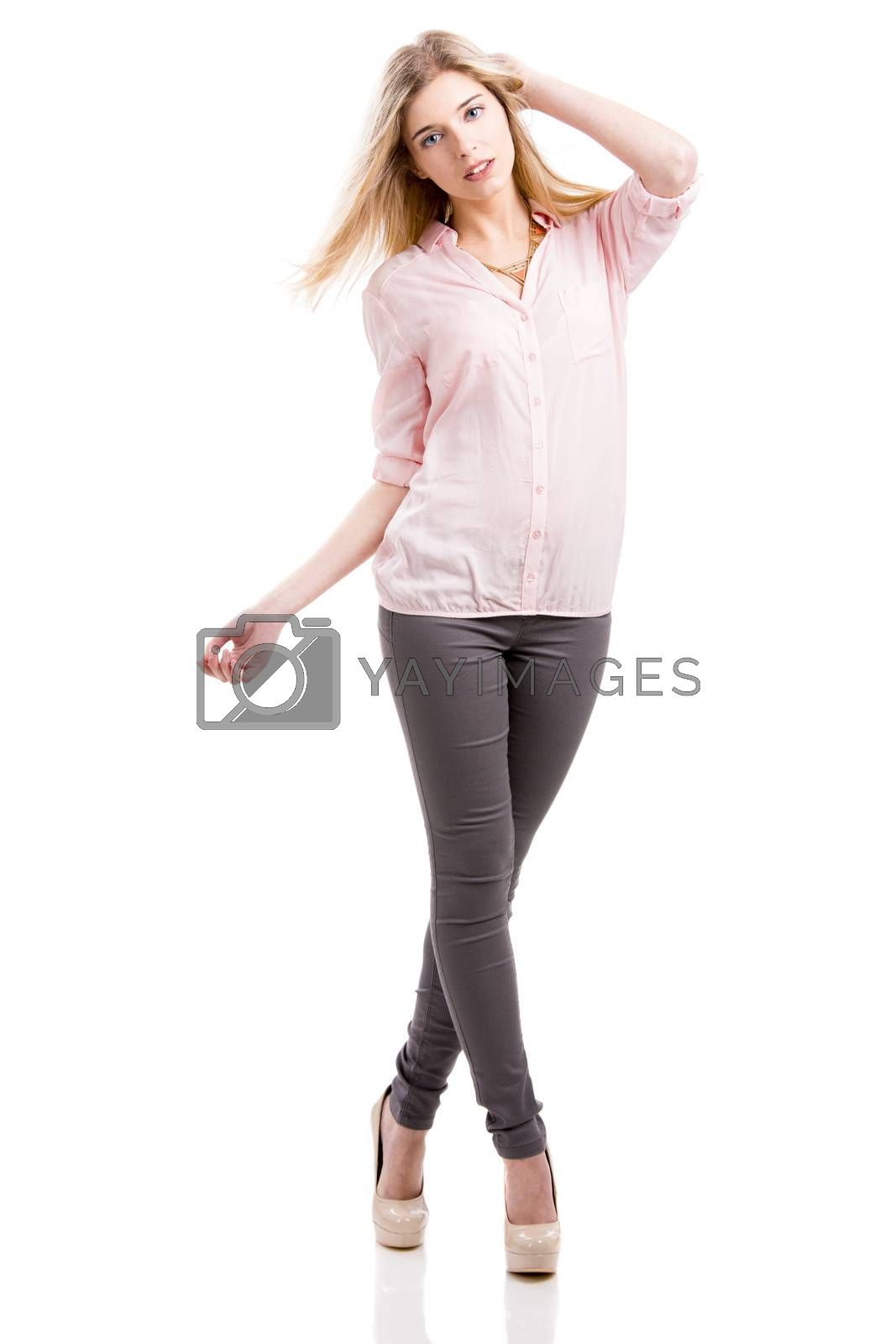Beautiful and attractive fashion woman smiling and posing, isolated over white background