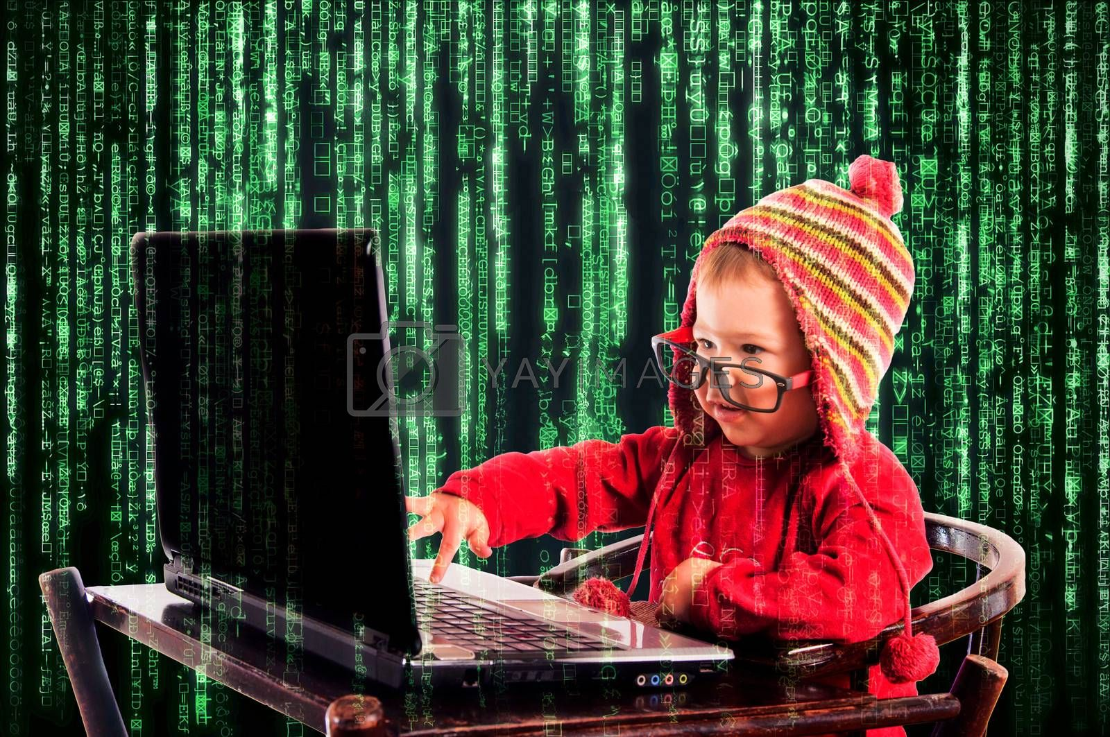 Little child typing on the keyboard.Selective focus on the child