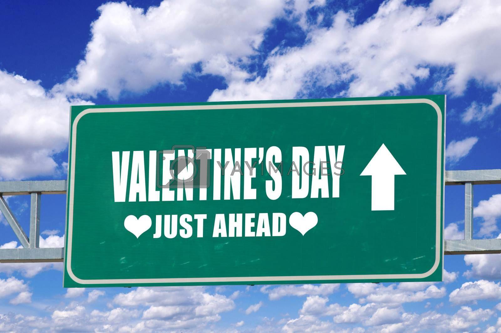 Valentine's day sign on the green board with clouds in background