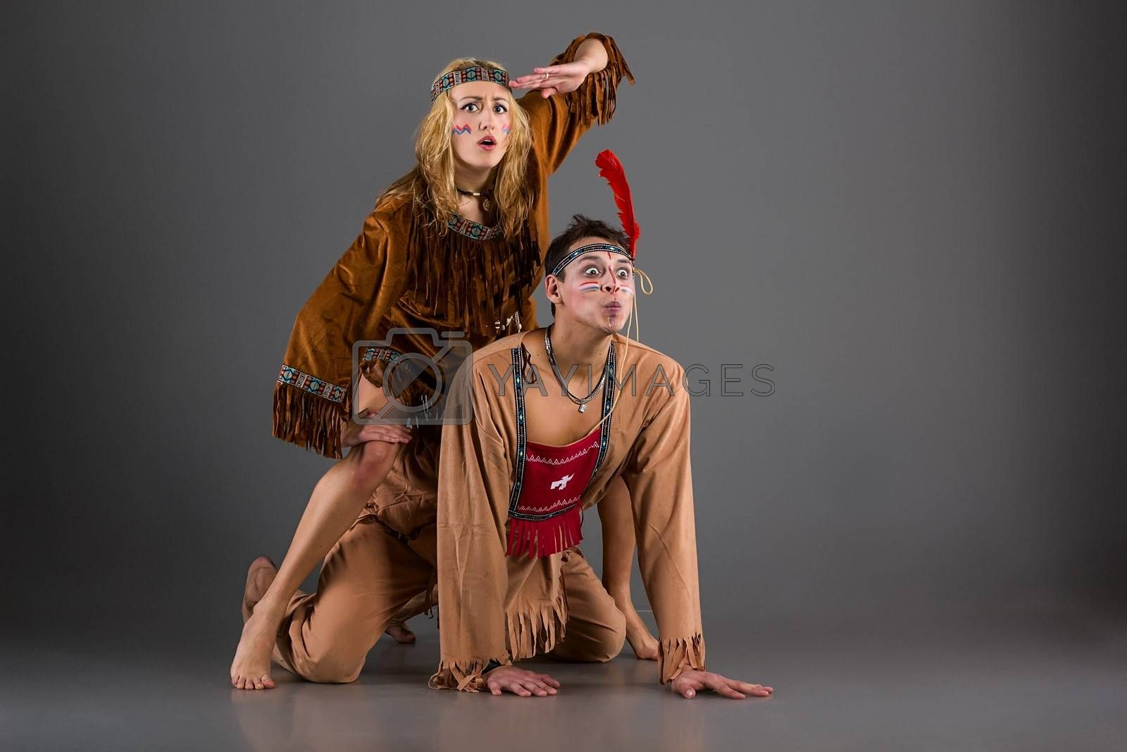 Man and wiman as american indian characters at studio