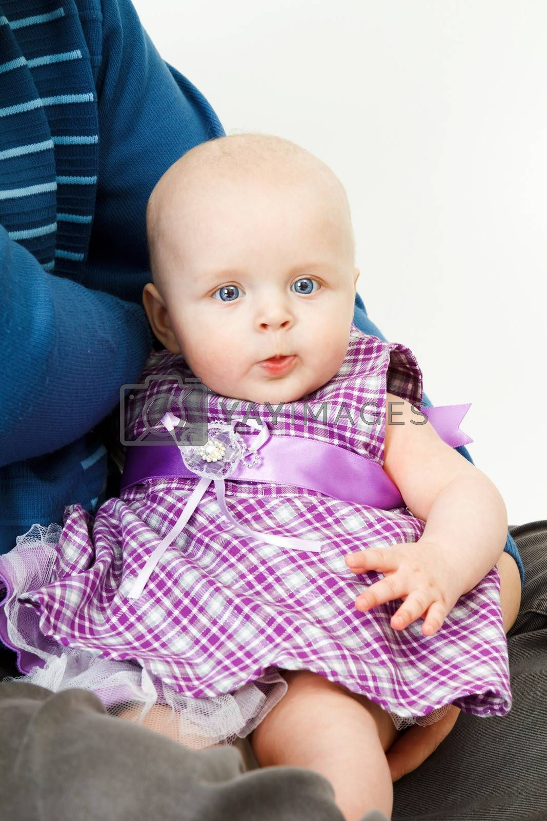 beautiful half-year-old baby girl on the hands of his father