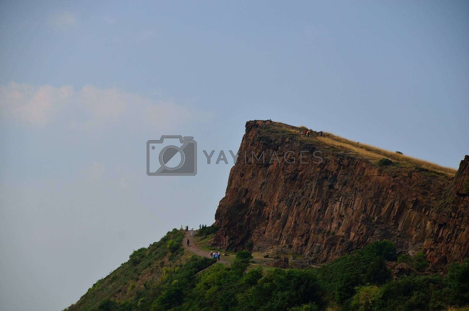 arthur seat in scotland with many walkers show details