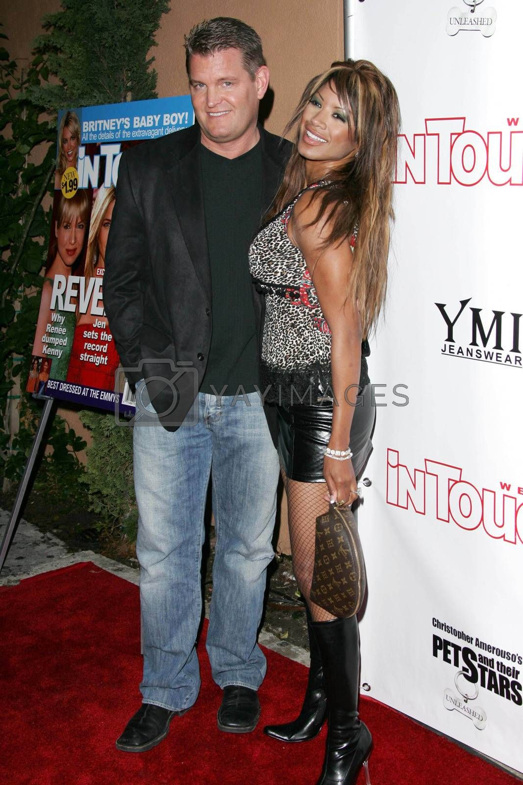 John Edward Yarbrough and Traci Bingham at the In Touch Presents Pets And Their Stars Party, Cabana Club, Hollywood, CA 09-21-05
