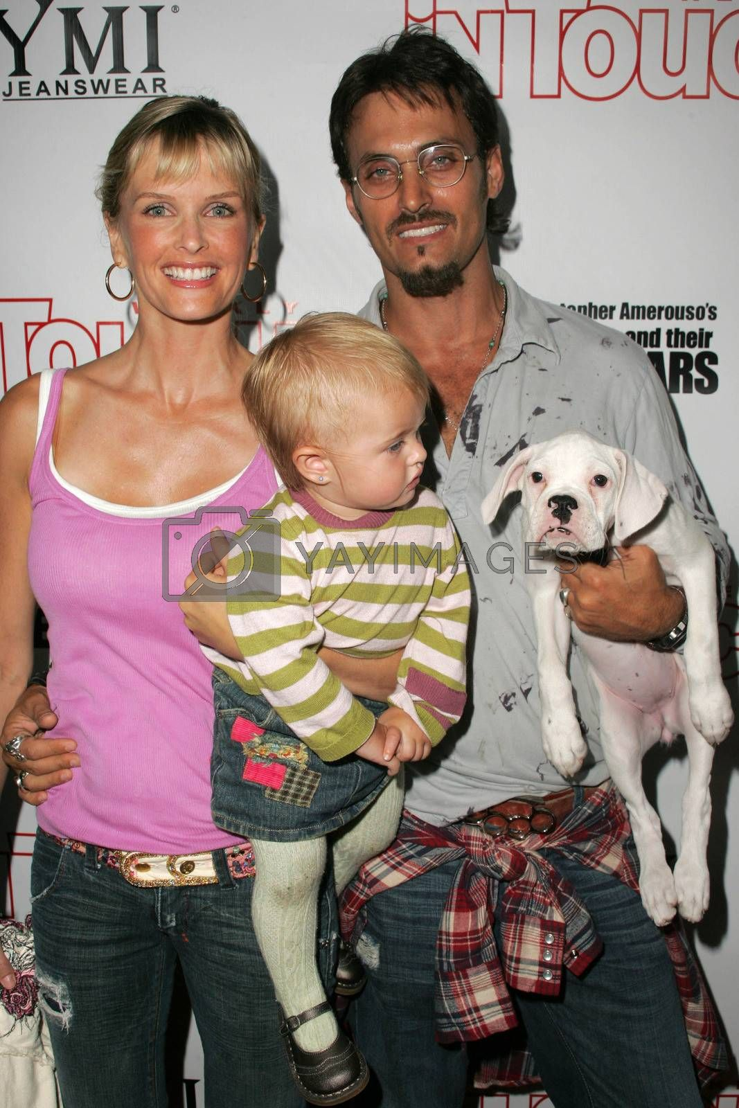 Kylie Bax with daughter Lito and husband Spiros Poros at the In Touch Presents Pets And Their Stars Party, Cabana Club, Hollywood, CA 09-21-05