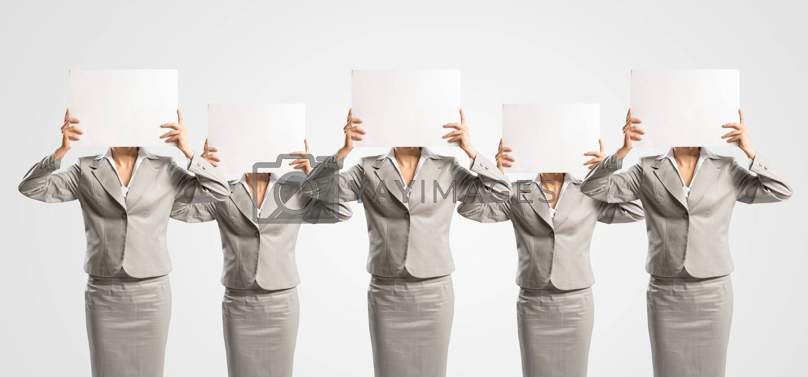 image of a businesswomen standing in a row, held in front of a blank poster