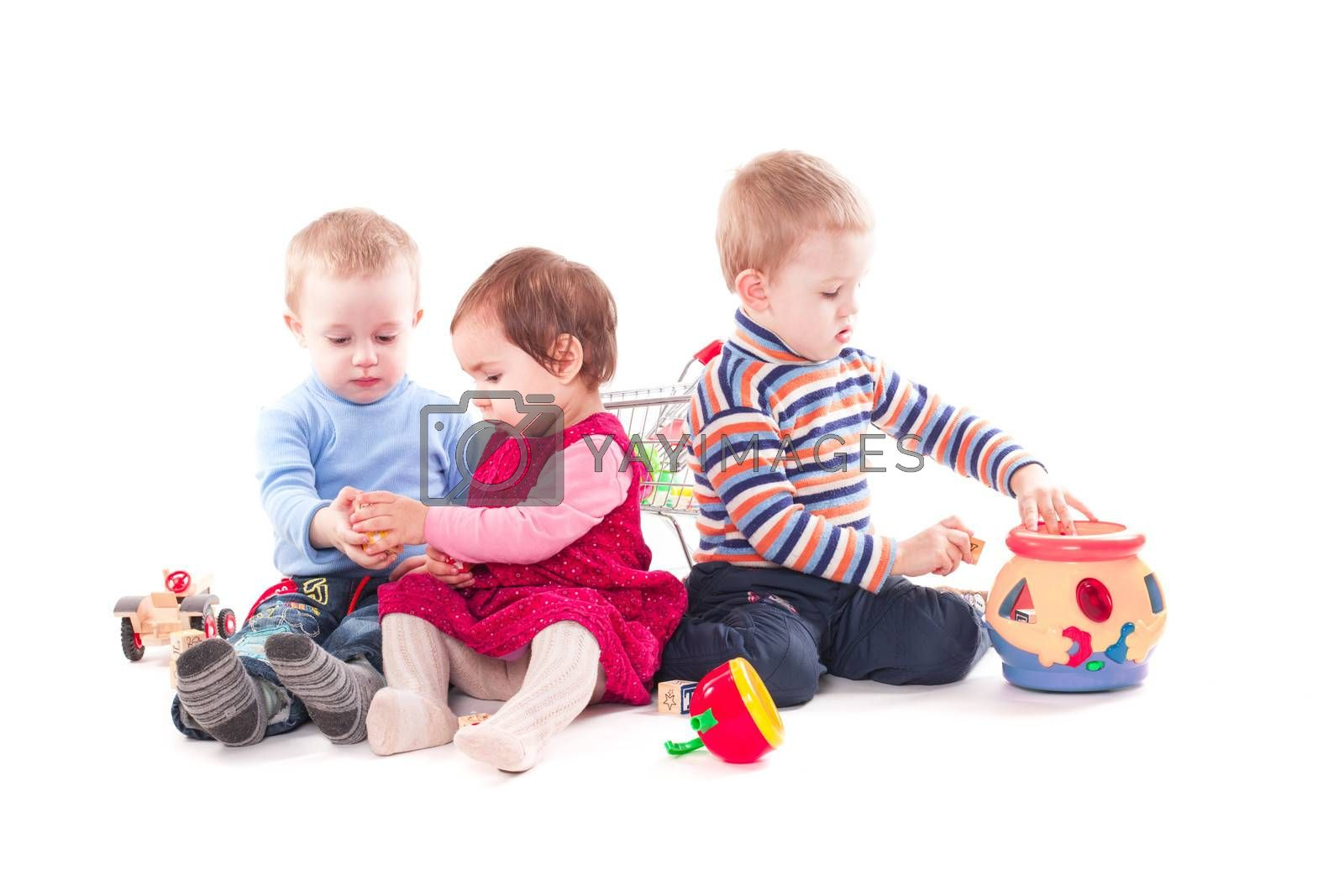 Three children play by oksix