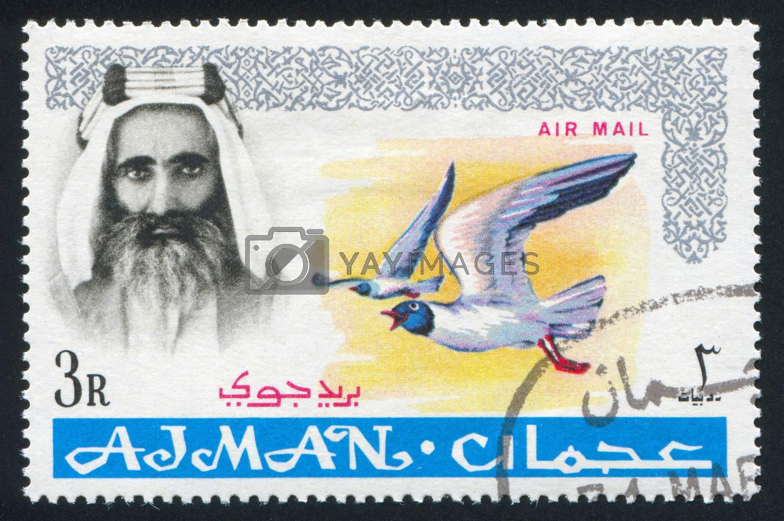 AJMAN - CIRCA 1964: stamp printed by Ajman, shows Sheik Rashid bin Humaid al Naimi and bird, circa 1964