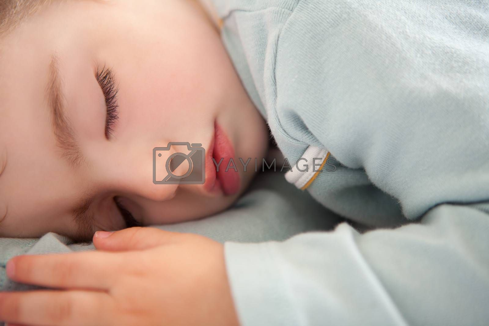 baby toddler sleeping closed eyes relaxed in soft blue