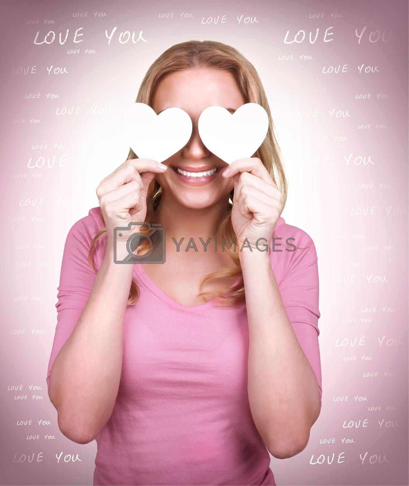 Portrait of cute loving girl with two hearts on the eyes, blind from love, isolated on pink background, happy Valentine day, affection concept